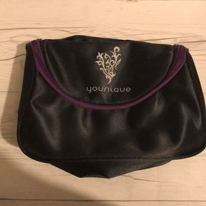 Younique black and purple make up bag